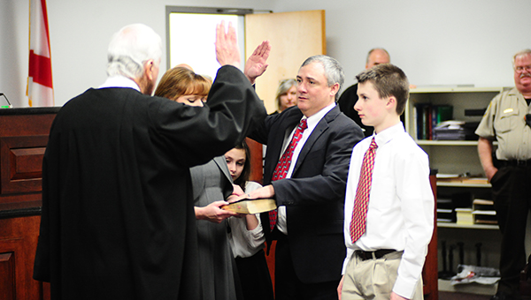 Daniel Crowson was sworn in by his father Al Crowson to appoint him as a Shelby County District Court Judge on Friday, Feb. 20. (Reporter Photo/Graham Brooks)