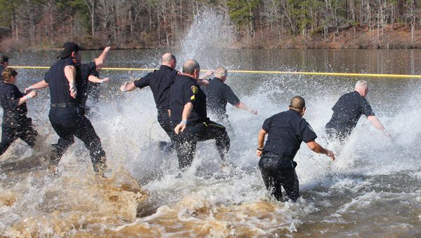 The Pelham Police Department running into Oak Mountain Lake during the 5th annual Polar Plunge on Saturday, Jan. 31. (contributed/ Eric Starling)
