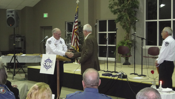 Chelsea C.O.P. member and City Council member Dale Neuendorf gives former Shelby County Sheriff Chris Curry an award for his support of the C.O.P. since its formation in the late 1990s. (Reporter Photo/Emily Sparacino)
