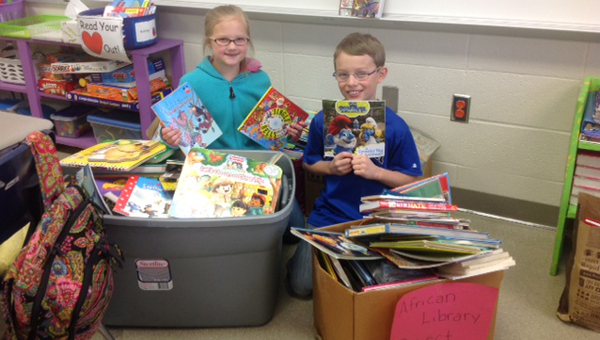 Led by the Forest Oaks Student Council, the school community collected books to send to Mbita Primary School in Swaziland. (Contributed)