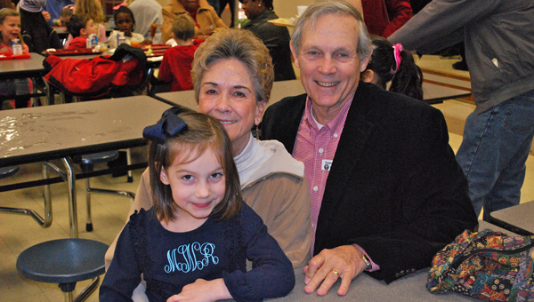 Maggie Wolfe enjoys lunch with her grandparents, Linda and Steve Mackin, during Inverness Elementary School's Grandparents Day celebration on Feb. 19. (Reporter Photo / Molly Davidson)