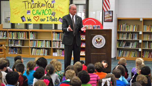 State Sen. Jabo Waggoner speaks with OMES first grade students on Feb. 12. (Reporter Photo / Molly Davidson)