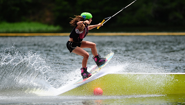 A young wakeboarder tackles the zipline obstacle course at Oak Mountain State Park in Pelham. Pelham recently was named one of the top Alabama cities for young families. (File)