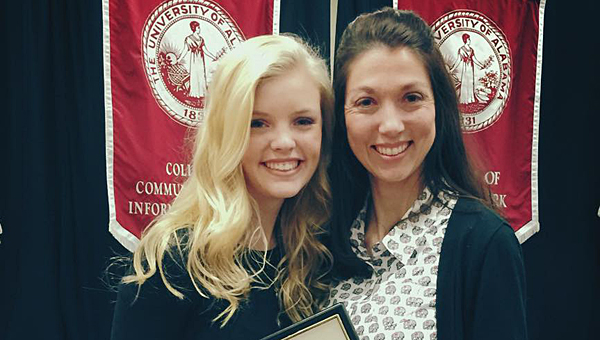 Thompson High School senior Amber Harless, left, won the state Broadcast Journalist of the Year award at a recent state conference. She is joined by her teacher, Brooke Dennis, right. (Contributed)