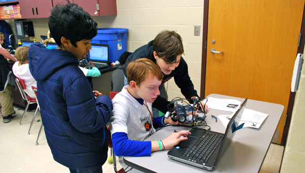 Brock's Gap Intermediate School students work together on a program for their robot during the Jan. 31 Super Bowl Challenge robotics competition. (Reporter Photo / Molly Davidson)