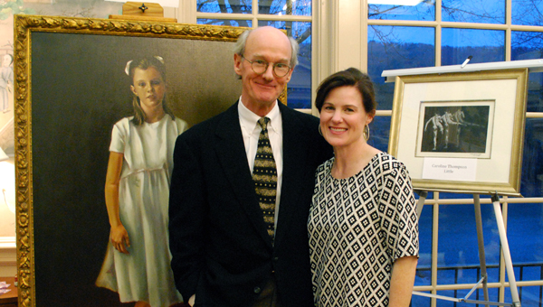 The talented father-daughter duo, George Thompson and Caroline Thompson Little, stand in front of their pieces displayed at the Shoal Creek Clubhouse on Feb. 21. (Reporter Photo / Molly Davidson)