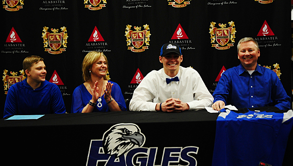 THS senior Kyle Sample dons a Faulkner University hat as he is surrounded by, from left, his brother Landon, mother Tammy and father Danny. (Reporter Photo/Neal Wagner)