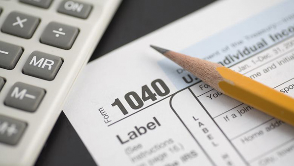 The North Shelby Library will offer free tax return prep help through the VITA Program on Saturday, Feb. 7. (File)