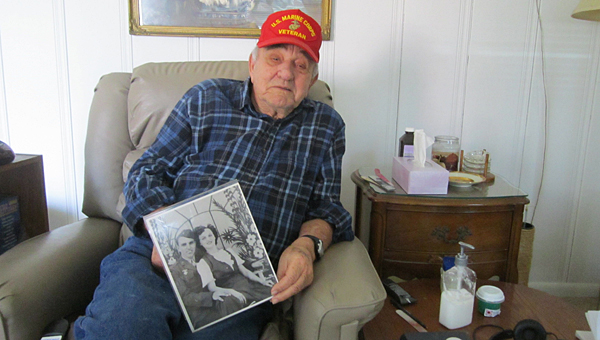 Alabaster resident William Taylor displays a photograph of himself and his late wife, Ida, at his house on Feb. 25. (Special to the Reporter/Ginny McCarley)
