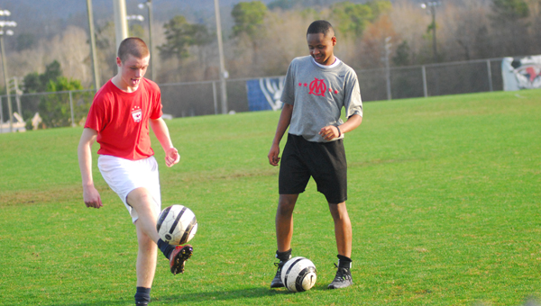 Chad Jeter (left) and Kennedy Davis kick around after practice. Jeter and Davis are members of Daniel DeMasters' Oak Mountain soccer squad that is looking for a great 2015 campaign. (Reporter Photo / Baker Ellis)