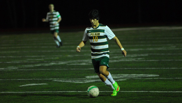 Amilcar Canas Aguilar looks to pass in Pelham's 6-0 win against Helena on March 3. (Reporter Photo / Baker Ellis)
