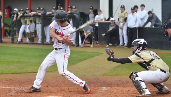 Stephan Poplin unloads on a ball in the first inning to drive in a run during the second game of Thompson's doubleheader on March 12. (Reporter Photo / Baker Ellis)