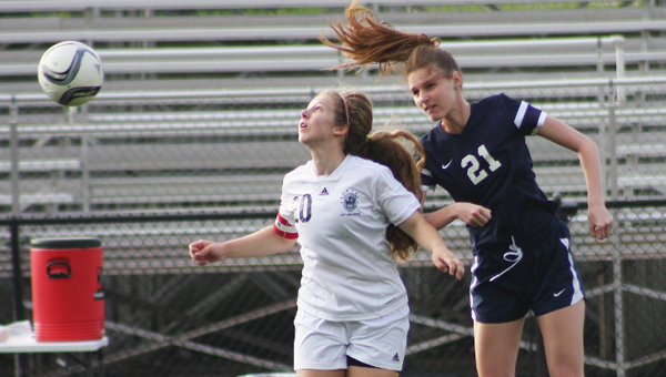 Briarwood senior defender Kat Smith (left) challenges for a ball during Briarwood's 5-1 victory over Trinity on March 19. (Contributed)