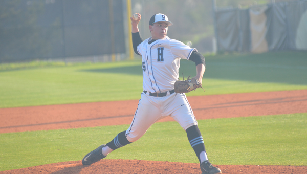 Brooks Freeman of Helena pitched a complete game in the first game of a doubleheader on March 17 against Pelham. Freeman and the Huskies won the first, but dropped the second and the schools broke even on the day, each winning one game. (Reporter Photo / Baker Ellis)