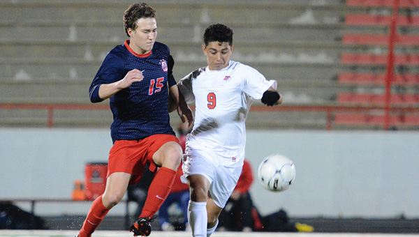 Christian Thomason of Oak Mountain battles Thompson's Diego Gutierrez for possession of a ball during their March 13 game. Oak Mountain won 4-2 to stay perfect in area play. (Contributed / Troya Yoder)