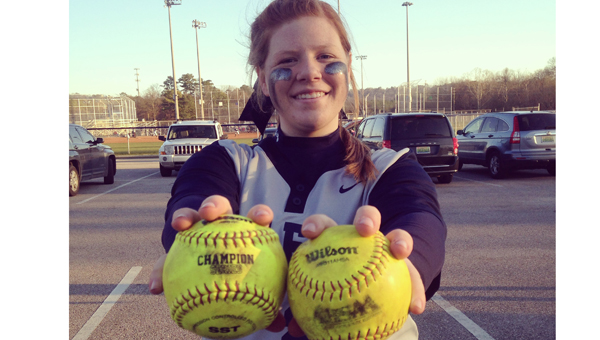 Shelby Wright of Calera displays her two home run balls she hit in a Feb. 28 contest against John Carroll. Calera went 3-0 on the weekend. (Contributed)