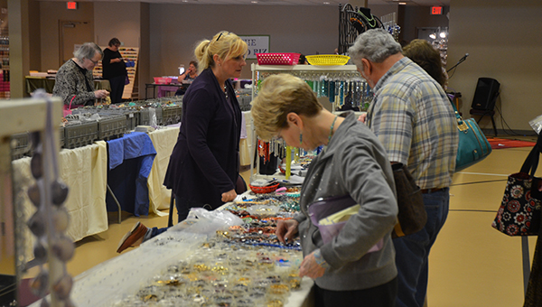 Customers browsed numerous tables of different beaded jewelry at Helena's Beadapalooza event held at the Helena Sports Complex March 14-15. (Reporter Photo/Graham Brooks)