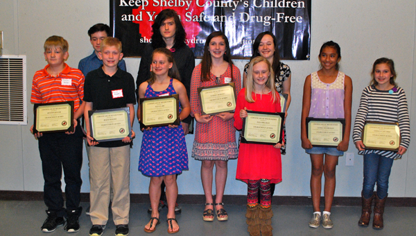 "Ten Shelby County Schools students were given ""Character in Action"" awards on March 19. (Reporter Photo / Molly Davidson)"