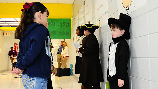 "Meadow View Elementary School third-grader Luke Bowen, right, portrays Abraham Lincoln during the school's ""living wax museum"" on March 20. He is joined by Seven Bishop portraying Samuel Adams and Ashlyn Gamble portraying Michelle Obama. (Reporter Photo/Neal Wagner)"