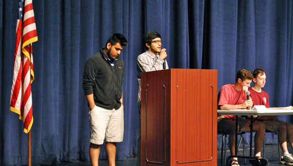 Students present a bill on distracted driving prevention during a mock session of Congress at Oak Mountain High School on March 25. (Reporter Photo / Molly Davidson)