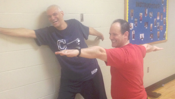 Tim Beiro, left, with instructor Andy Savage participate in a body flow class at the Calera YMCA. (Contributed)