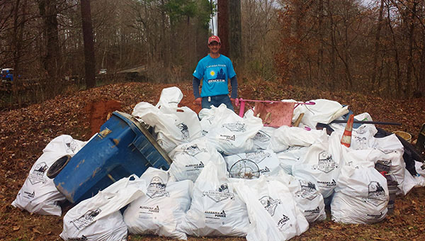 Event Organizer David Butler stands behind just a portion of the trash that was collected from Buck Creek on Saturday, March 14. (Contributed)
