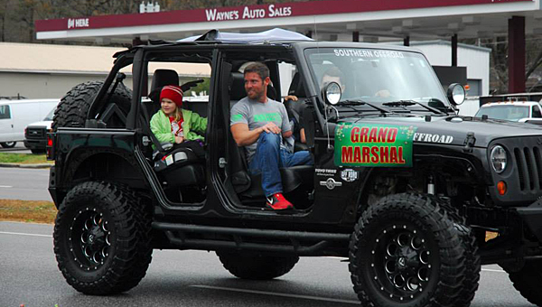 Noah Galloway, right, a current contestant on Dancing with the Stars, marshals the 2014 Alabaster Christmas Parade. (Reporter Photo/Neal Wagner)