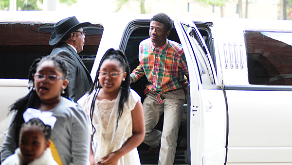 Members of Alabaster's Kids First Awareness Community Center exit a stretch limousine during a March 27 event at the Alabaster First United Methodist Church Restore building. (Reporter Photo/Neal Wagner)