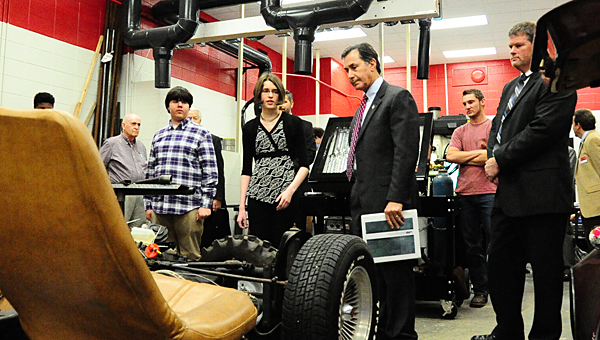 Thompson High School engineering students, from left, Ryan Hosey and Rachel Hixson explain their electric car project to U.S. Congressman Gary Palmer as THS engineering instructor Brian Copes, right, looks on. (Reporter Photo/Neal Wagner)