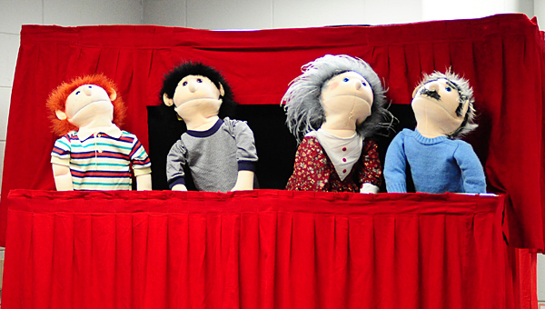 Owen's House presents a puppet show to Meadow View Elementary first-graders on March 4. The show focused on identifying and reporting different types of abuse. (Reporter Photo/Neal Wagner)