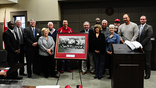 Members of the Bentley and Busby families join Alabaster school leaders as they present a photo of Thompson High School's first football team to the city school system on March 9. (Reporter Photo/Neal Wagner)