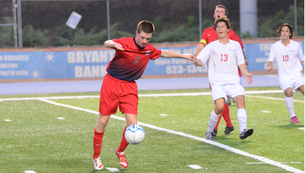 Chad Jeter of Oak Mountain turns to take one of the few decent chances at goal the Eagles had in a April 14 matchup with rival Vestavia. The two teams are ranked second and third in the state, respectively, but the Eagles could not match the Rebels on this night, and fell 4-0. (Reporter Photo / Baker Ellis)