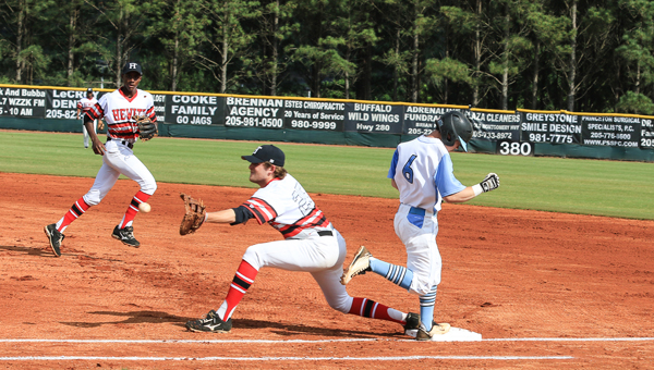 Jacob Rich beats out a throw to first base during Spain Park's April 15 game against Hewitt Trussville. The Jaguars defeated the Huskies at Hewitt Trussville the day before, but lost at home 0-3. (Contributed/Dawn Harrison )