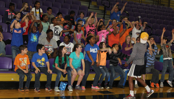 "Montevallo fifth-grade students do ""the wave"" during the first ever Future Falcons Day at the University of Montevallo. The event was led by current coaches and student-athletes at the University. (Contributed)"