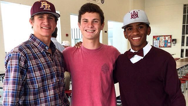 Graham Hackbarth, left, and Austin Whitaker, right, shown here with teammate Logan Gibbs in center. Hackbarth recently signed a scholarship to play baseball for Pearl River Community College in Mississippi while Whitaker signed to play for Alabama A&M. (Contributed)