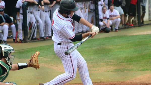 Jonathan Crawford takes a cut at a pitch in the opening game of the series between Thompson and Mountain Brook. The Warriors beat the Spartans two games to one and will advance to the second round where they will take on Vestavia Hills. (Reporter Photo / Baker Ellis)