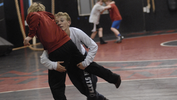 Two young wrestlers practice technique at the Alabaster Wrestling Club on April 2. (Reporter Photo / Baker Ellis)