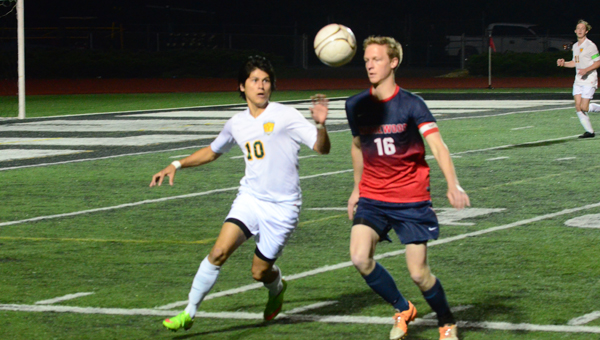 Amilcar Canas Aguilar, left, of Pelham, fights a Homewood player for the ball in the early going of Pelham's second round 6A state tournament game with Homewood on April 28. The Panthers scored a goal in overtime to knock off the Patriots 1-0 and advance to the third round of the 6A playoffs for the first time in school history. (Reporter Photo / Baker Ellis
