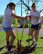 Two UM students offer their service to the community during The Big Event, held in Montevallo April 11. Almost 700 students served at 57 job sites, making this, the fifth year of the event, the largest volunteer effort in the event's history at UM. (Contributed)