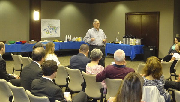 Chelsea Mayor Earl Niven speaks to a crowd at the South Shelby Chamber of Commerce's Coffee with the Mayor on April 16 at Chelsea City Hall. (Reporter Photo/Emily Sparacino)