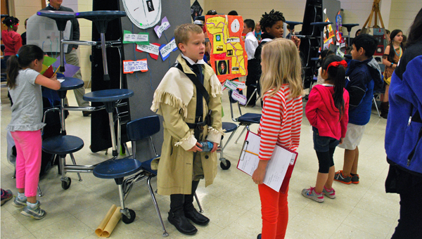 Jackson Beard, dressed as American explorer William Clark,  gives his speech about Clark during the Inverness Elementary School wax museum presentation on April 29. (Reporter Photo / Molly Davidson)