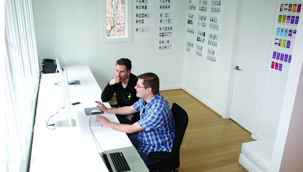 Markus Beige and Jason Terry work on a new iPhone app in Beige's Mt Laurel home office. (Contributed / Joanna Lea)