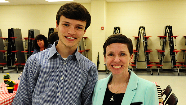The Alabaster Education Association presented $1,000 scholarships to Thompson High School senior Nicholas Colburn and THS math teacher Meghan Craig during an April 28 ceremony. (Reporter Photo/Neal Wagner)