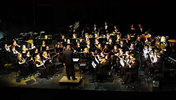 The THS wind ensemble performs a benefit concert for one of its members battling leukemia on April 14 in the school's auditorium. (Reporter Photo/Neal Wagner)