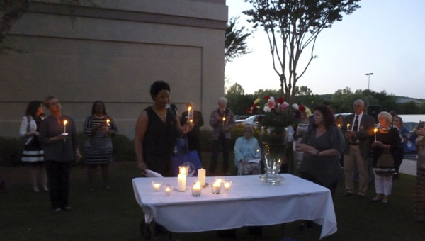 Advocate Awards Presentation and Banquet hosted by the SafeHouse of Shelby County and the Central Alabama Chapter of VOCAL (Victims of Crime and Leniency) Emcee Eunice Elliott, NBC 13 Channel 13, concludes the Candlelight Service remembering those murdered of violent crime. A candle was lit and flower placed in the vase for each victim for their loved one by their survivor. (Contributed)