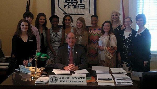 Helena Teen Council members took a tour of the state capital and pose with State Treasurer Young Boozer in his office. (Contributed)