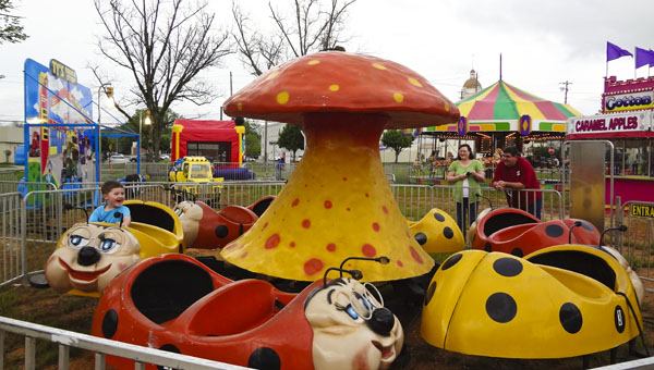 "Kellen Houston enjoys a ""Granny Bugs"" ride at the Columbiana Spring Carnival on April 10. (Reporter Photo/Emily Sparacino)"