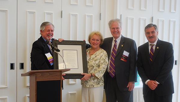 Michael and Donna Grainger are presented with a gift after donating $500,000 to the University of Montevallo to establish the Michael J. and Donna H. Grainger Endowed Chair in Business and Accounting. (Reporter Photo/Graham Brooks)