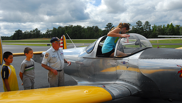 Johnny Ward, second from right, shows a group of children his 1946 Air Coupe during a previous Young Eagles Day at the Shelby County Airport. (Reporter Photo/Neal Wagner)
