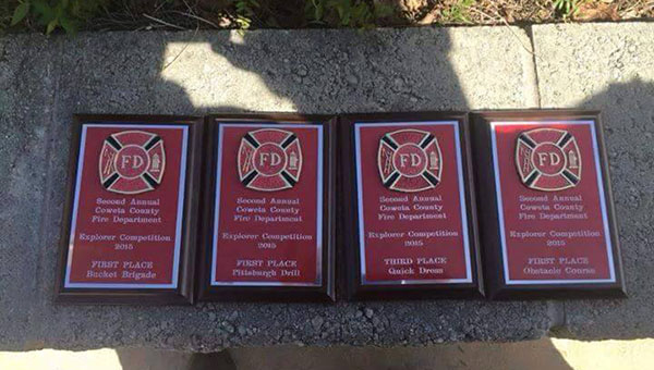 The Helena Fire Explorers received three first place awards and one third place award in a competiton in Coweta County, Georgia. (Contributed)